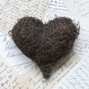 Wire heart on letters